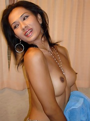 Gorgeous Asian T-girl shows tits