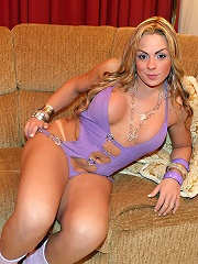 Sexy Andressa in a purple outfit strokers her thick Brazilian cock