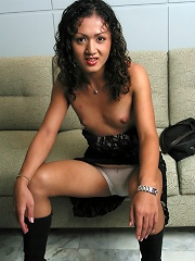 Pretty-faced Ladyboy strips naked on couch