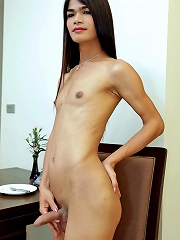 Tall, slim and sexy ladyboy strokes cock