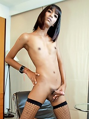 Exotic ladyboy Tyra stretches open her ass