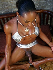 Voloptous black shemale stroking her cock and playing with her tits